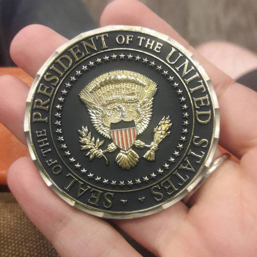 Image of Roman Mars' Presidential challenge coin.