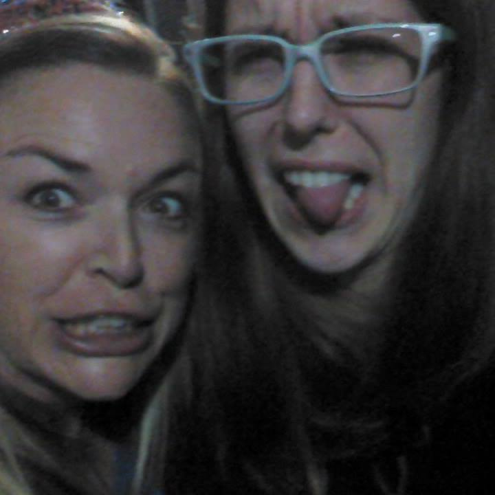 Image of my cousin and I all grown up on her birthday, pulling faces. She's wearing a birthday bitch crown and has maybe downed a shot already. I'm stone cold sober but making a sillier face.