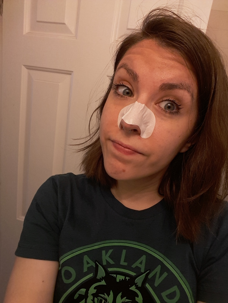 Picture of me wearing Tonymoly egg pore nose strip.
