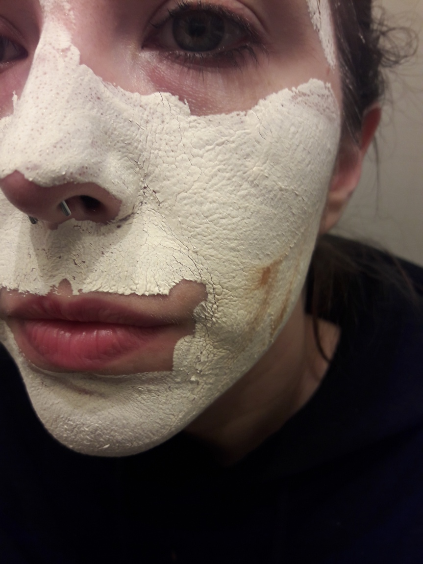 The dried kangsipack mask. It looks nothing like the fun, gold mask I applied. It's white and crusty.
