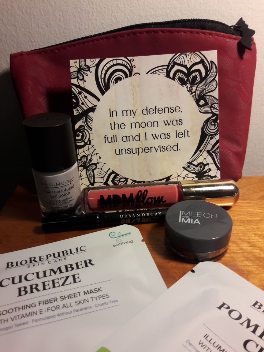 "Image of October 2017 Ipsy bag and contents. The bag is a dark red lace and comes with a little card that says ""In my defense, the moon was full and I was left unsupervised."""