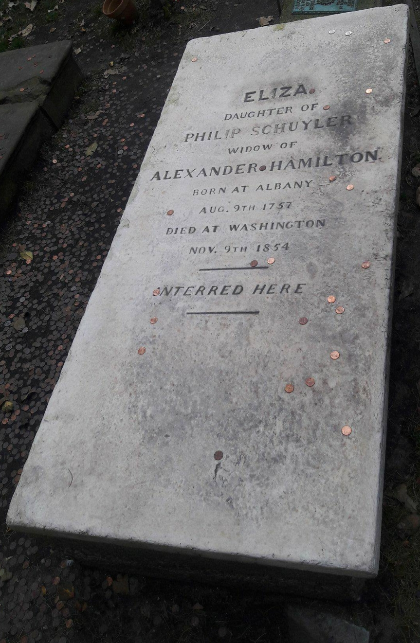 "Eliza's grave at Trinity Church. It reads ""Eliza daughter of Philip Schuyler widow of Alexander Hamilton born at Albany Aug. 9th 1757 died at Washington Nov. 9th 1854 interred here."" People have left her pennies."