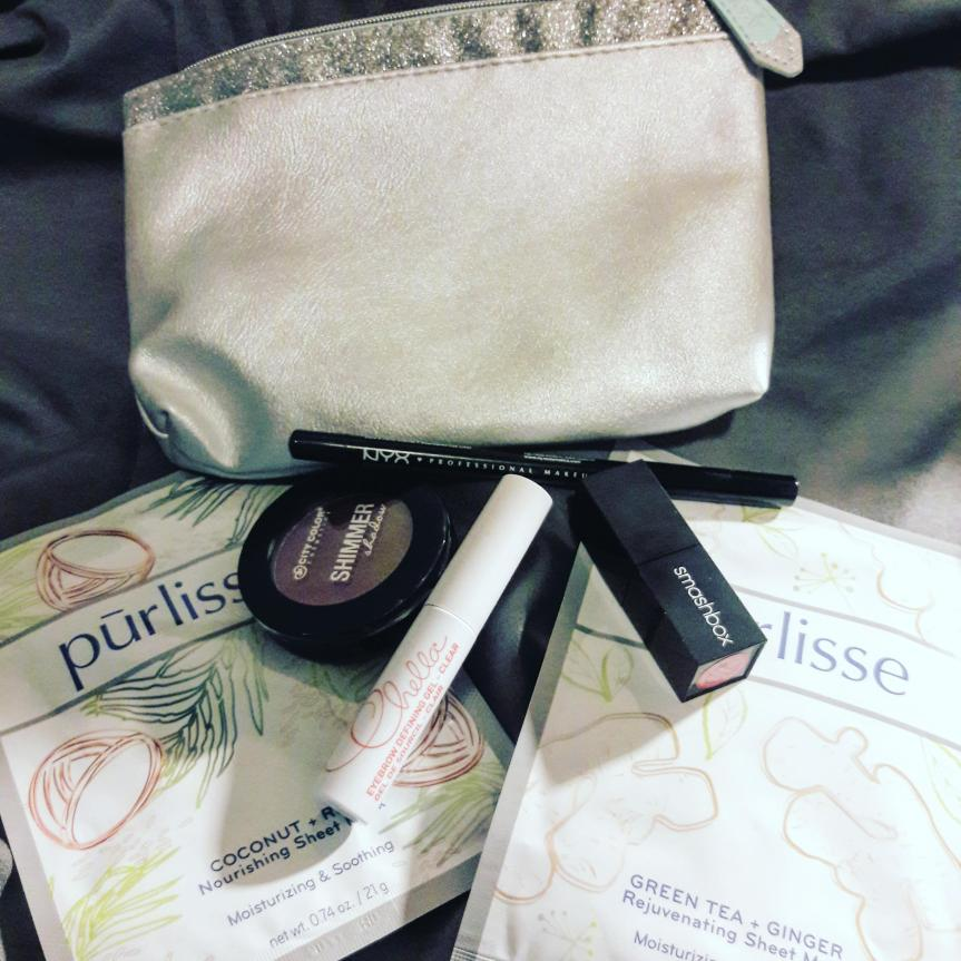 December 2017 ipsy bag and contents. This month's bag is a very light aquamarine blue with a silver glitter fringe.