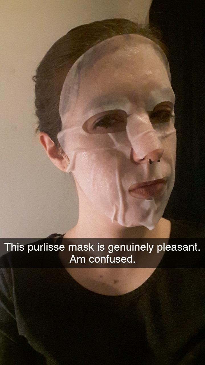 "Me wearing the Purlisse mask, looking suspicious. It's got a snapchat caption that reads ""This purlisse mask is genuinely pleasant. Am confused."""