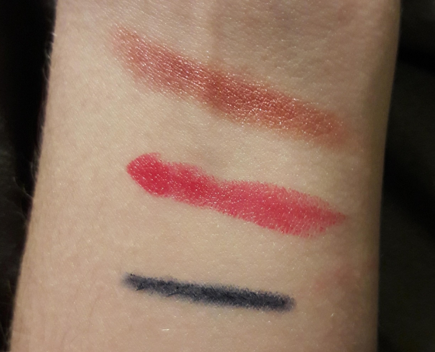 Arm swatches. The lipstick looks very thin.