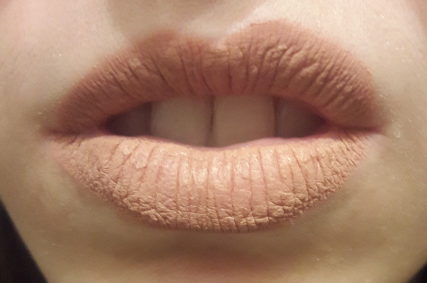 NYX PROFESSIONAL MAKEUP Lip Lingerie in Satin Ribbon on my lips. It's a shade darker than my skin (which is pasty white) and settles into every line of my lips.