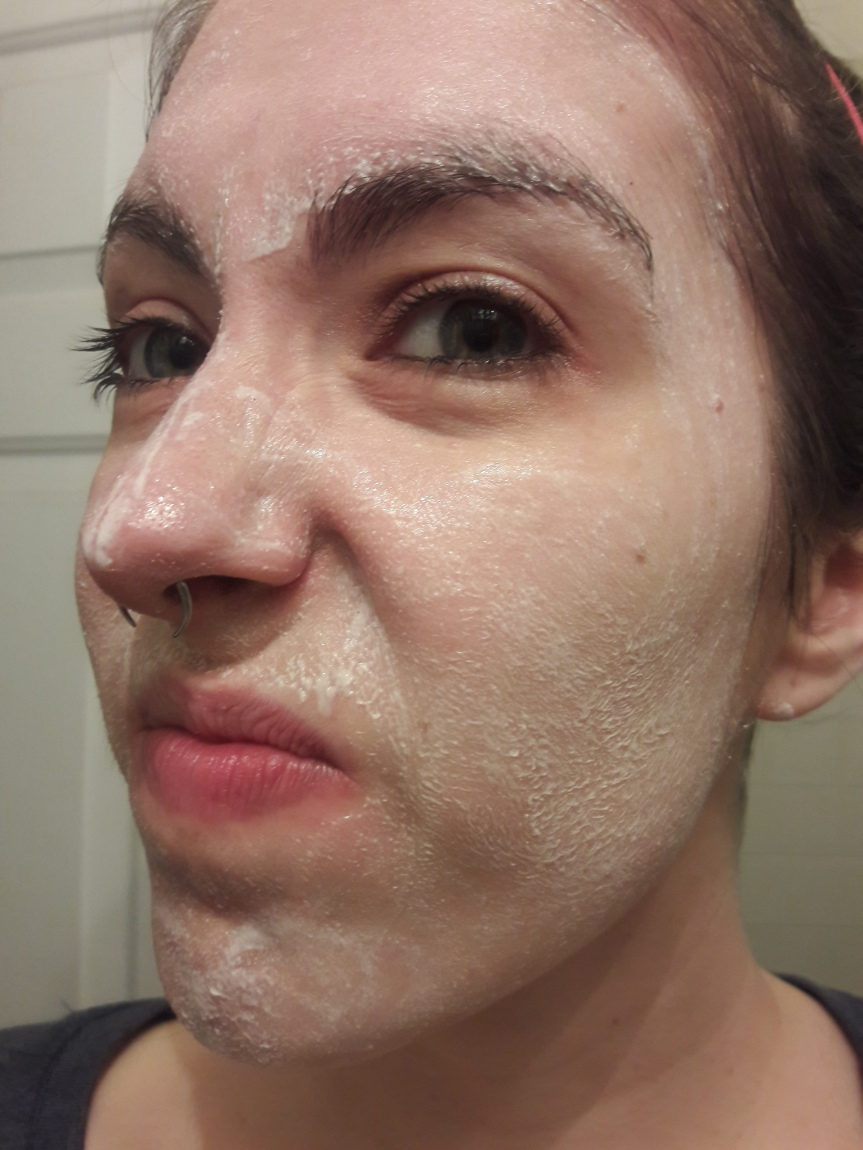 My face with the Dermelect Microfacial Exfoliating Masque applied. I don't look entirely pleased.