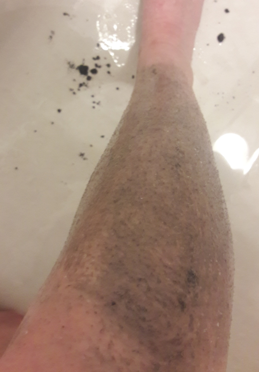 Blaq meteor scrub pre-rinsing. My leg is very gray.
