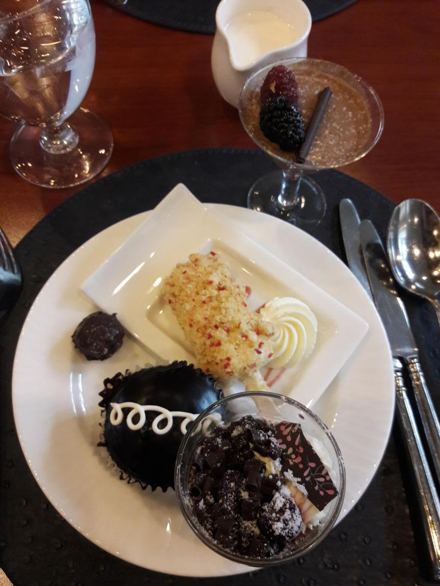 One plate of desserts from our dessert buffet. I've got two things of chocolate mousse, a truffle, a fancy hostess cupcake, and a fancy version of those strawberry shortcake ice creams.