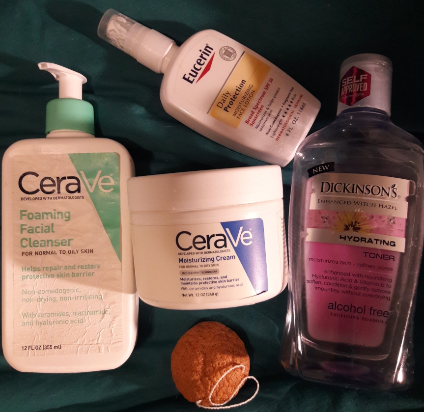 Image of my current morning skincare products. I've got a konjac sponge, CeraVe foaming facial cleanser, CeraVe moisturizing cream, Eucerin SPF lotion, and Dickinson's witch hazel toner.