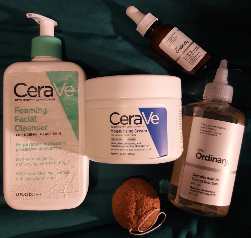Image of my current night time skincare products. I've got the konjac sponge, CeraVe foaming facial cleanser, and CeraVe moisturizing cream again. I've also added The Ordinary's Glycolic Acid 7% Toning Solution and Granactive Retinoid 2% emulsion.