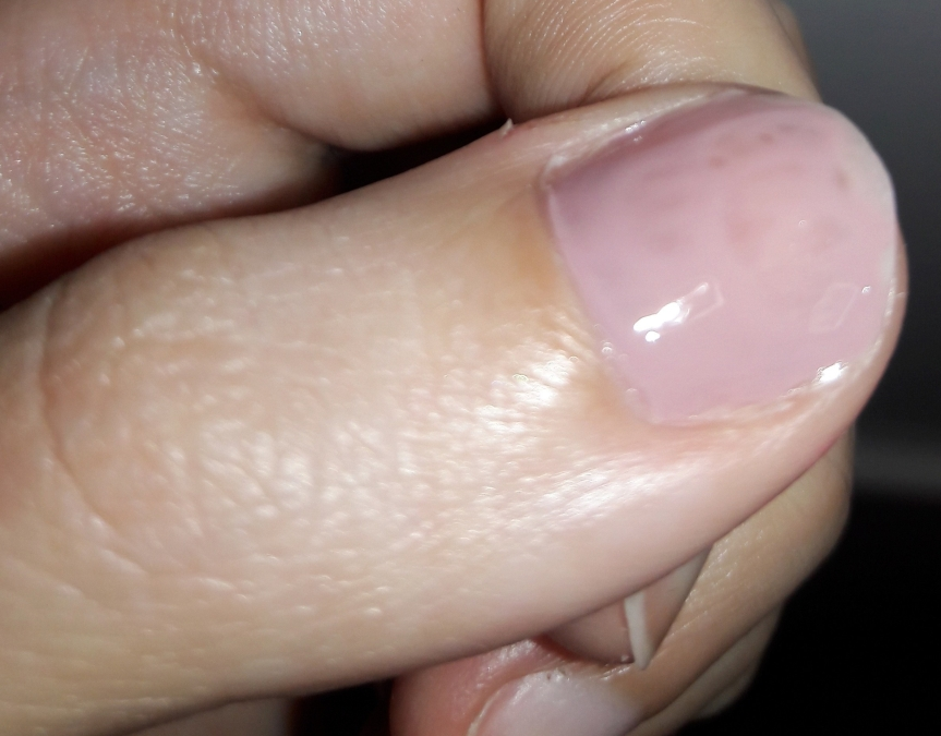 Pretty Woman nail polish in Girl Boss on my thumb nail. It's a very light lavender color.