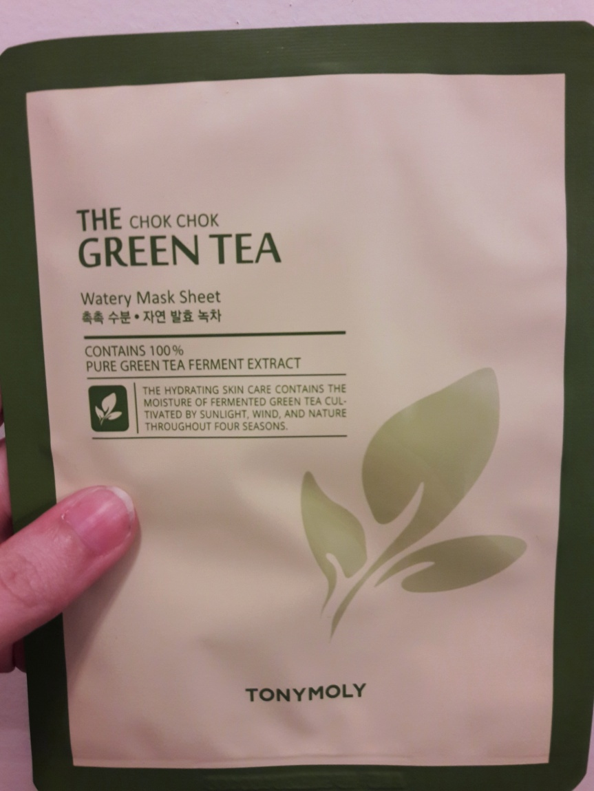 Image of the front of Tonymoly's The Chok Chok Green Tea watery mask sheet (sheet mask). It's pretty minimalist and touts that it contains 100% pure green tea ferment extract.