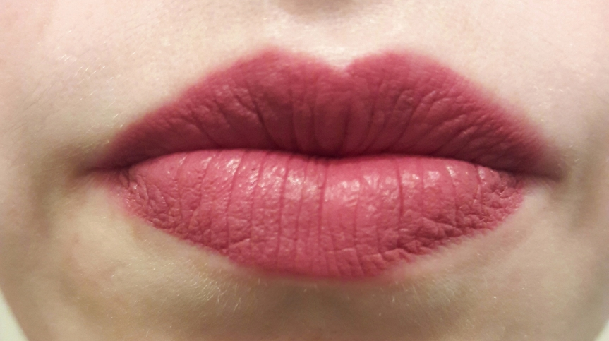 "Lip swatch of the ofra lipstick in unzipped. Nothing weird here. It's a ""nude berry"" color."