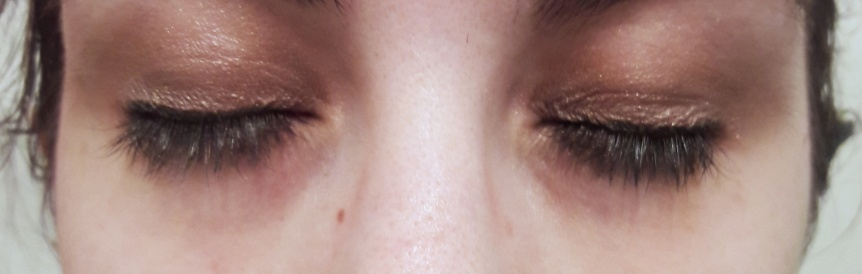 My closed eyes wearing the eye shadow and eyeliner. Both have a subtle shimmer to them.