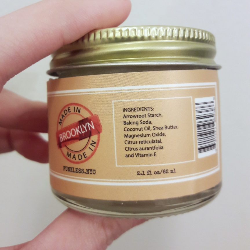 Back of the jar. Made in Brooklyn. Ingredients list: Arrowroot starch, baking soda, coconut oil, shea butter, magnesium oxide, citrus reiculatal, citrus auranfolia, and vitamin E.