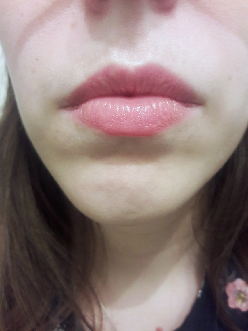 On my lips. A thin, baby pink.