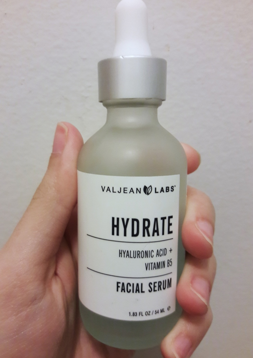 Valjean Labs' Hydrate facial serum with hyaluronic acid and vitamin b5. It's light blue liquid in a frosted dropper bottle.