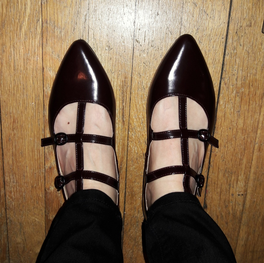Dark burgundy (though they look black here) Rocket Dog shoes. The toes are pointed and they've got a bunch of straps. I love them.