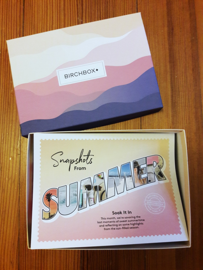 Image of the Birchbox. This month has some abstract purple and pink hills. The inside card says